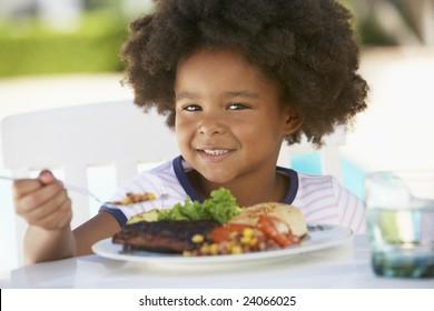 Young Girl Dining Al Fresco