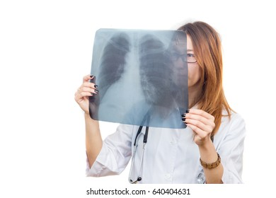 a young girl, the doctor looks at the lungs x-ray