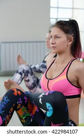 Young girl does stretching yoga exercise