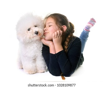 young girl and dog in front of white background