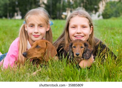 Young girl and dog - puppy dachshund