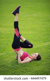 young girl  doing core workout at a stadium