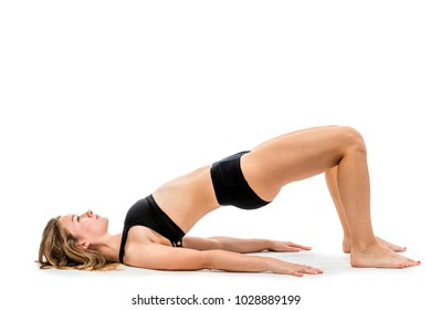young girl doing exercises in underwear on a white background