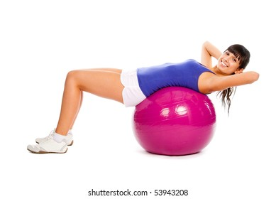 Young girl doing fitness on the ball