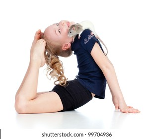 Young girl doing gymnastics. Domestic pet rat sits on her shoulder.