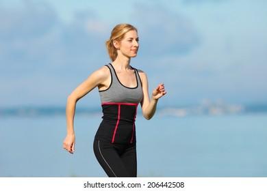 young girl doing gymnastics at the sea