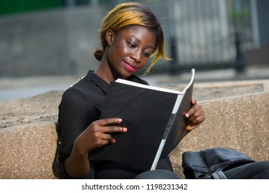 Young girl doing her chores and homework sitting on campus outside. College student
