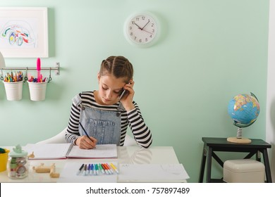 young girl doing homework at home