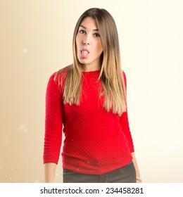 Young girl doing a joke over ocher background