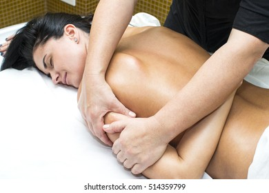 Young girl doing a massage in the beauty salon