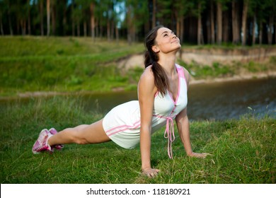 young girl doing stretching exercise relaxing and warm up