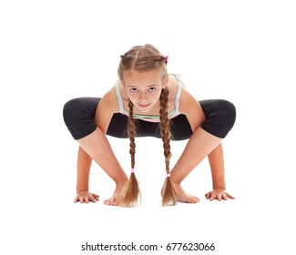 Young girl doing stretching and flexibility gymnastic exercise - front view, isolated