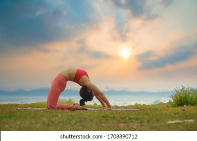 Young girl doing yoga fitness exercise outdoor