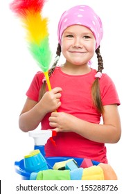 Young girl is dressed as a cleaning maid, holding static duster, isolated over white