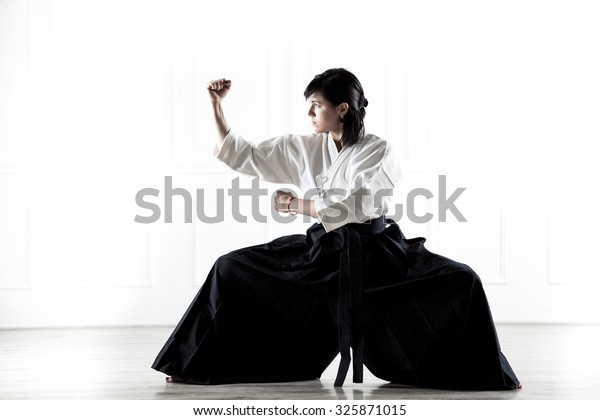 young girl dressed doing aikido