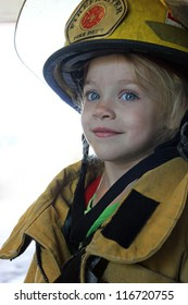a Young girl dressed as a firefighter