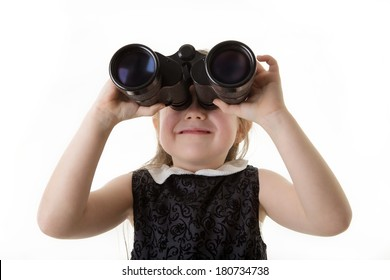 young girl dressed up in a office dress looking through binoculars