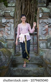 A young girl dressed in traditional Balinese clothing in Bali Indonesia.