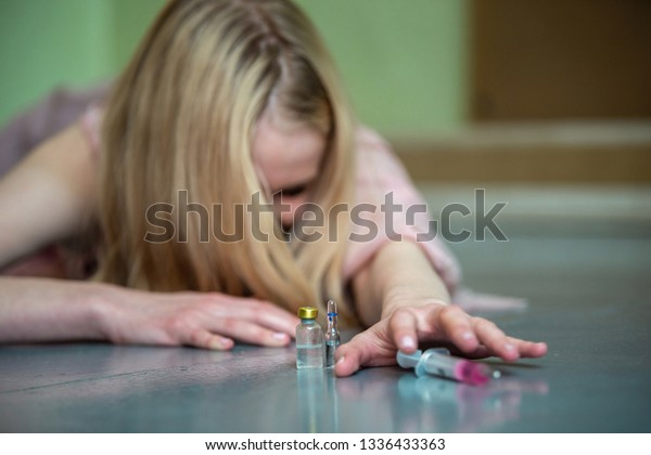 Young Girl Drug Addict Lies On Stock Photo (Edit Now) 1336433363