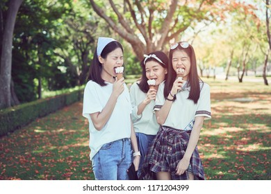 Young girl is eating ice cream and happy. At the time of relaxation.