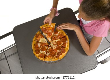 Young girl eating pizza with white background