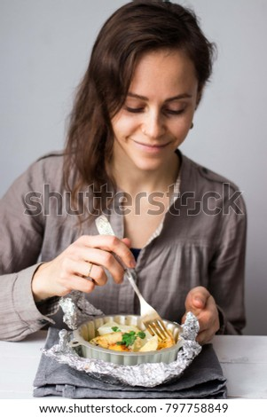 Young Girl Eating Spicy Baked Potato Stock Photo (Edit Now