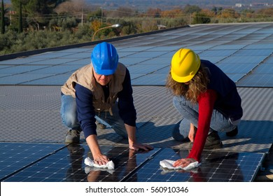 young girl and elderly man cleaning photovoltaic panels