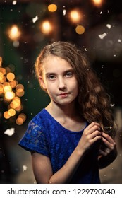 young girl in an elegant dress in a winter evening