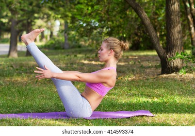 young girl engaged in fitness, gymnastics, yoga, boat pose