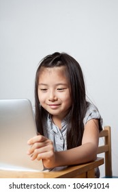 A young girl enjoy using  tablet