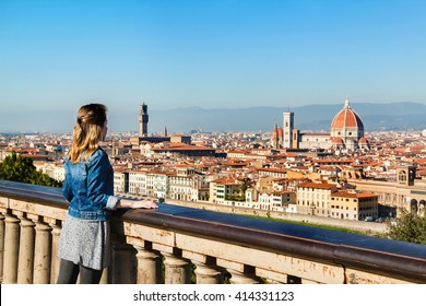 Young girl enjoying the panoramic view of Florence, Tuscany, Italy.