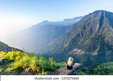 young girl enjoying the view of little adam's peak in Ella, Sri Lanka
