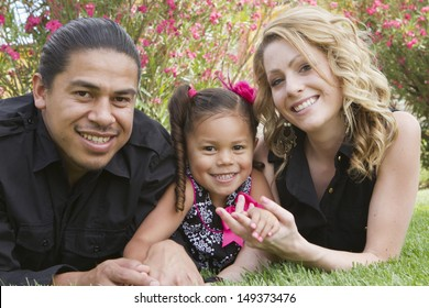 A young girl enjoys the afternoon with her family.