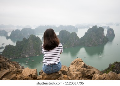 Young girl is excited with beautiful landscape of Ha Long bay