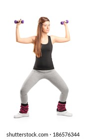 Young girl exercising with dumbbells isolated on white background