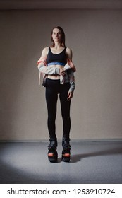 young girl exercising with kangoo shoes. beautiful and sport girl in the gym training. Kangoo jumping. Beautiful girls in Kangoo Jumping training in the gym