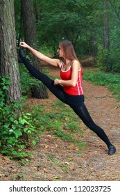 Young girl exercising in the park