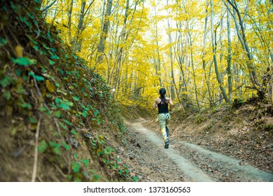 Young girl exercising in the woods
