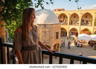 Young girl exploring Buyuk Han (the Great Inn), largest caravanserai in Cyprus. Nicosia