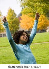 young girl expressing joy for life