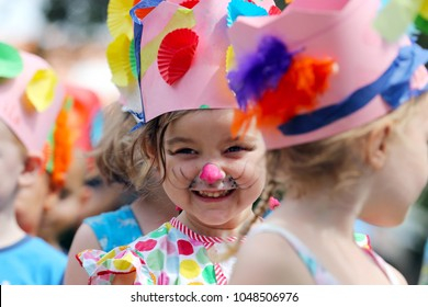 Young girl with face painted as a rabbit in the Easter hat parade at her kindergarten.