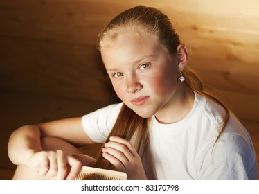 The young girl with a fair hair attentively looks in the chamber