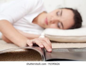 Young girl fallen a sleep as she read a book