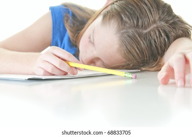 Young girl falling asleep during school work