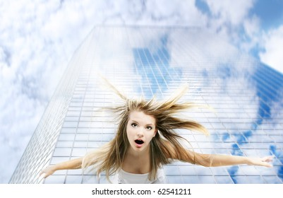 young girl falling down from skyscraper
