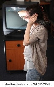 Young girl feeling pain from tv noise