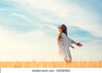 Young girl in a field - Shutterstock ID 520185841