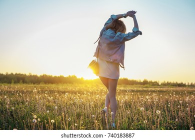 young girl in the field at sunset / girl in the field
