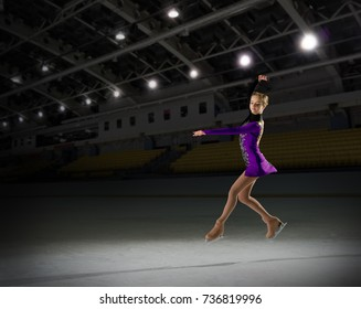Young girl figure skater in sports hall