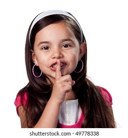 Young girl with fingers on lips